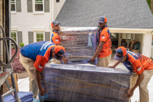 Local Movers Atlanta loading up furniture in a moving van