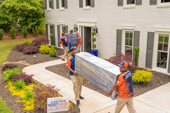Movers in Atlanta, carrying a couch