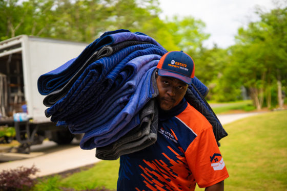 Residential Movers Carrying Mats From Truck in Atlanta