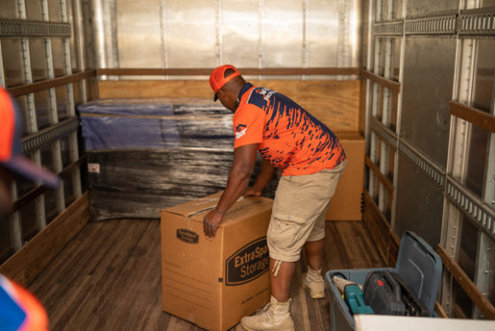 Man in Truck with Box as a Commercial and Office Mover in Fulton County, GA