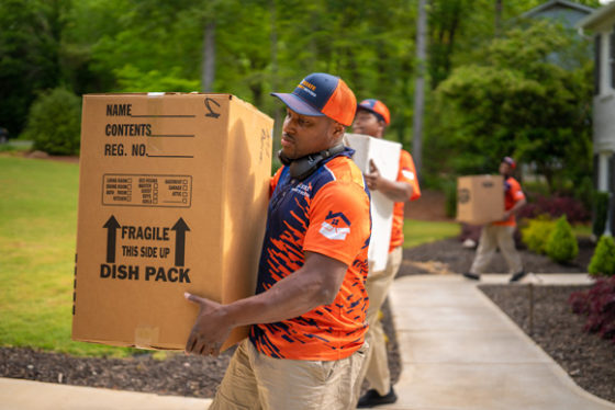 White-glove local movers in Fulton County carrying boxes to a home